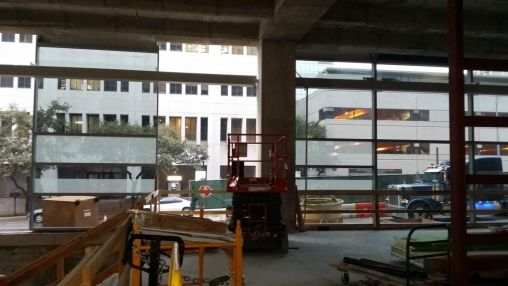 View of ASH through the partially constructed first floor curtain wall system.