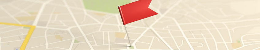 A red flag pinned to a map.