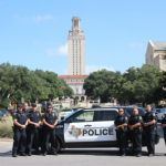 UT Austin PD lined up cars at cross streeets on campus, south of the Tower in line with the Capitol