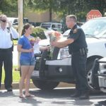 Officers from the UT Tyler PD gathered with other local law enforcement at Broadway Square Mall in Tyler, where they were greeted by a UT Tyler student with flowers and a thank you note.