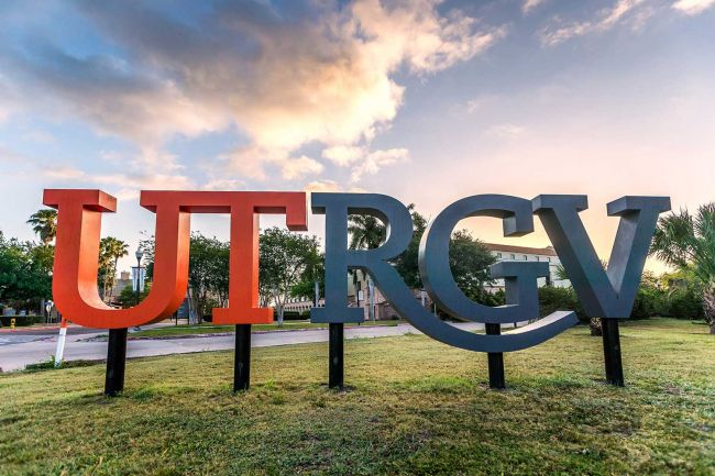 Outside signage with the letters UTRGV. UT is in orange, and RGV in a dark gray