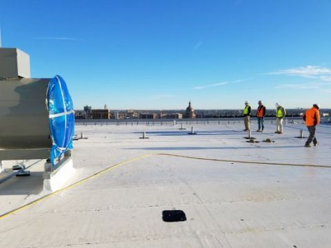 Photo from the east side of the roof looking north.  The big fan on the left is part of the stair pressurization system.