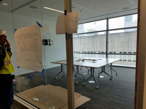 Tables in a small conference room are reconfigurable.