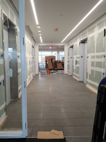 Typical elevator lobby being finished out.  The walls will be back-painted glass and stainless steel.