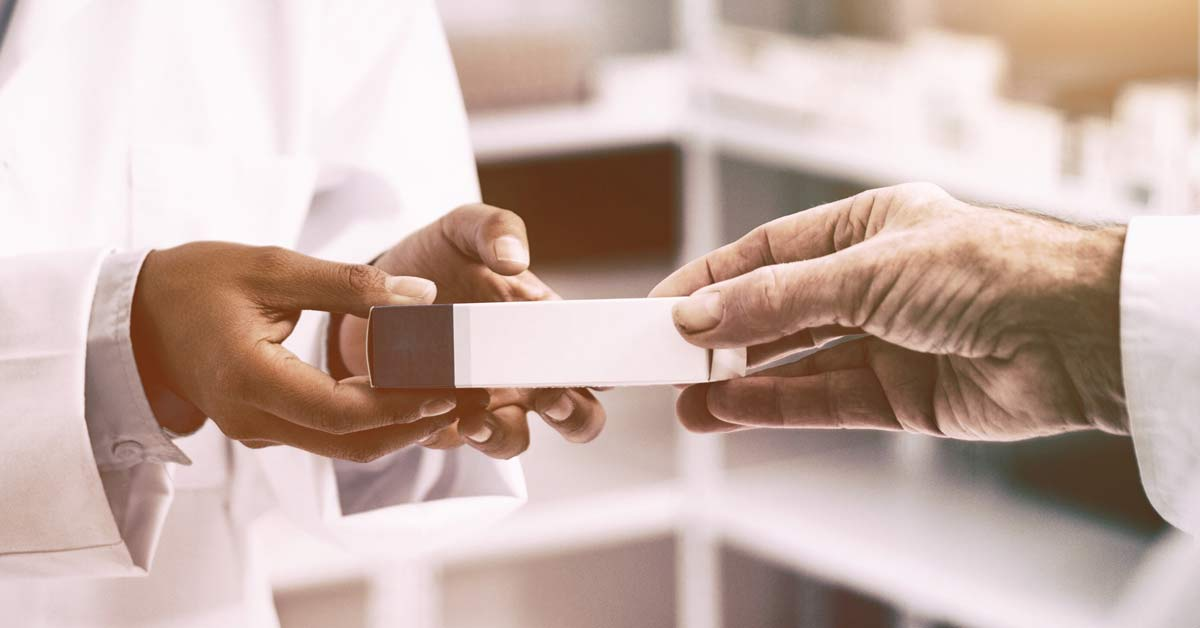 Pharmacists hands exchanging medication